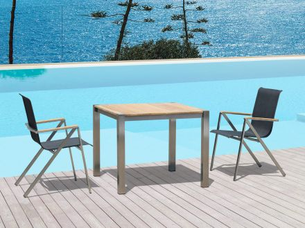 Vorschau: Edelstahl Gartenstuhl Plaza Ambientebild Sitzgruppenbeispiel mit Tisch Plaza